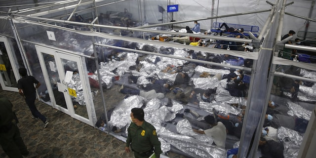 Young minors lie inside a pod at the Donna Department of Homeland Security holding facility, the main detention center for unaccompanied children in the Rio Grande Valley run by U.S. Customs and Border Protection in Donna, Texas. (AP Photo/Dario Lopez-Mills,Pool)