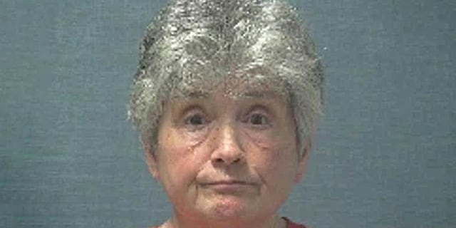 Janet Caplinger allegedly burned down the home she lost to foreclosure.