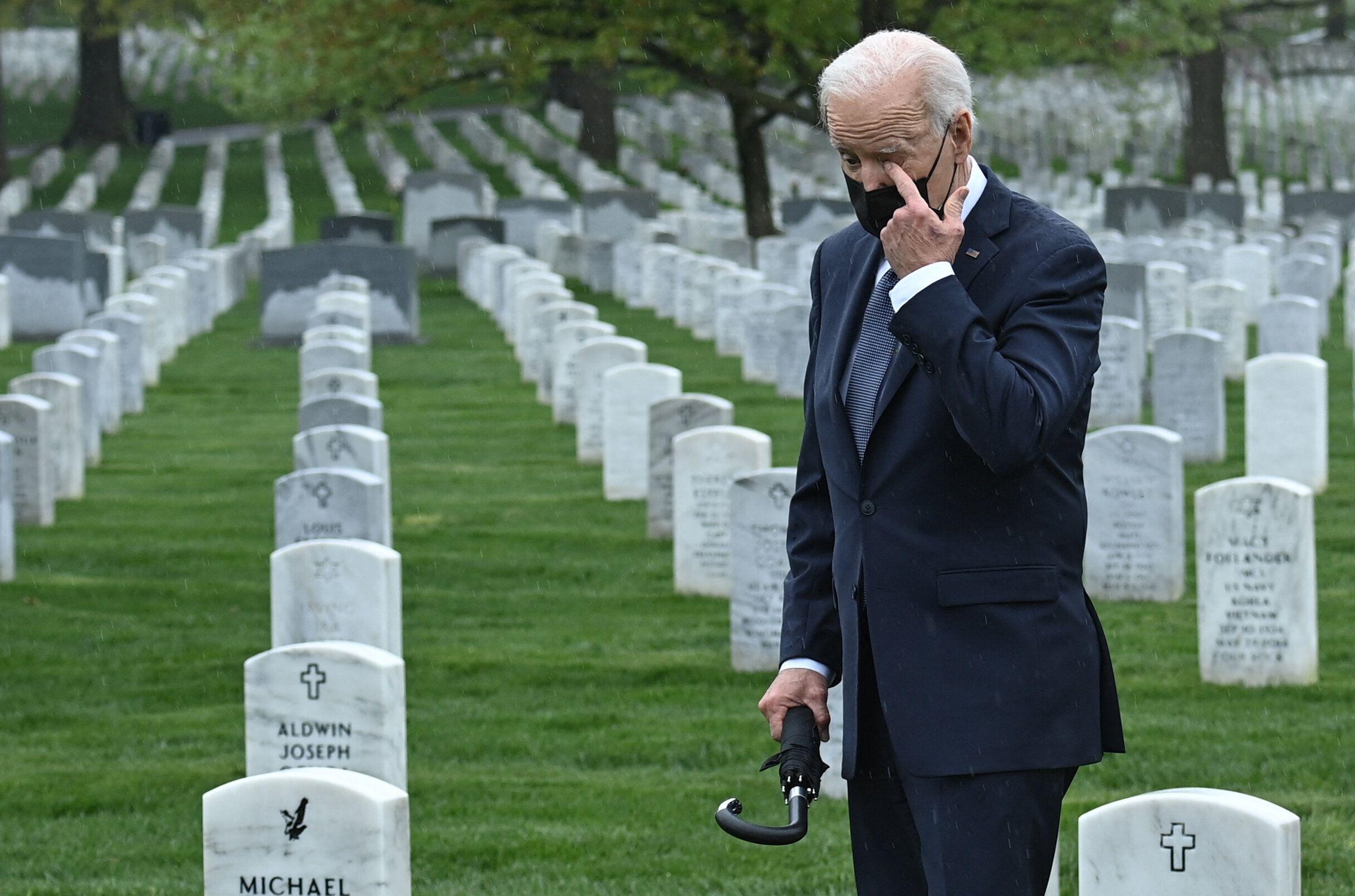 President Joe Biden wipes his eye as he walks through Arlington National Cemetery in Virginia on Wednesday.