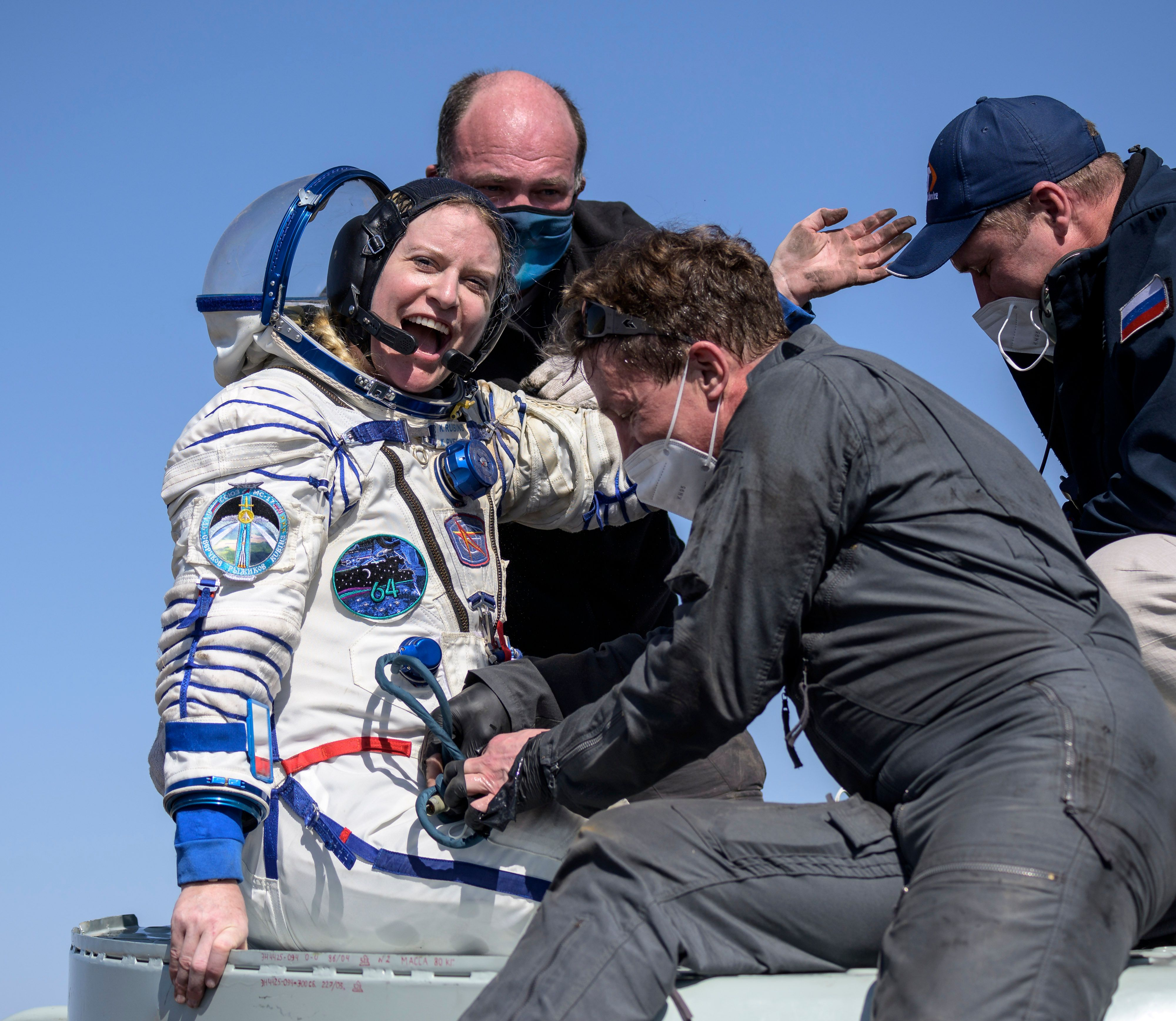 Expedition 64 NASA astronaut Kate Rubins is helped out of the Soyuz MS-17 spacecraft.