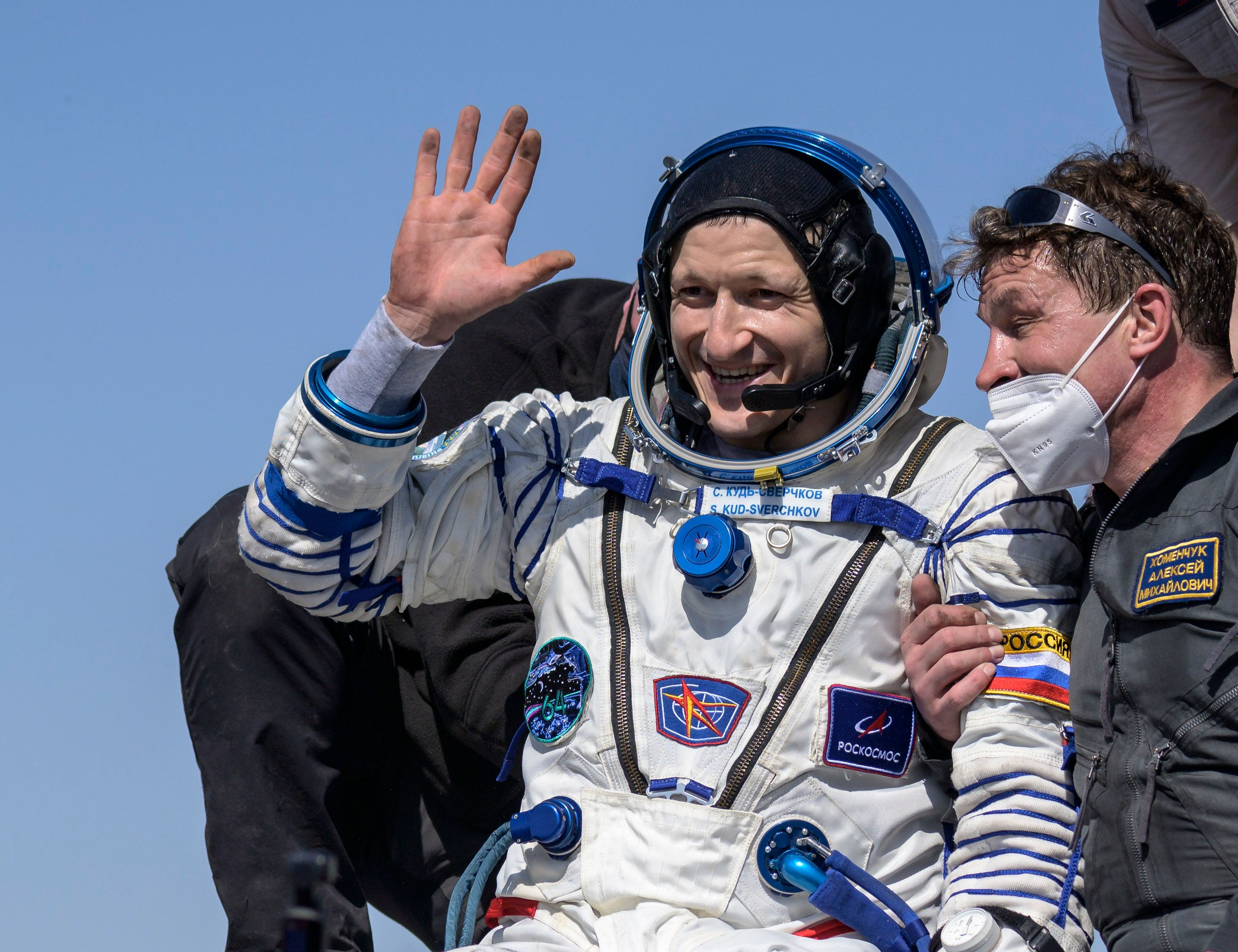 In this photo provided by NASA, Roscosmos cosmonaut Sergey Kud-Sverchkov is helped out of the Soyuz MS-17 spacecraft.