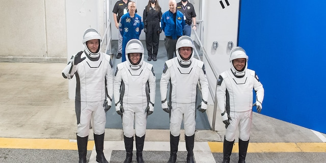 From left to right, ESA (European Space Agency) astronaut Thomas Pesquet, NASA astronauts Megan McArthur and Shane Kimbrough, and Japan Aerospace Exploration Agency (JAXA) astronaut Akihiko Hoshide, wearing SpaceX spacesuits, are seen as they prepare to depart the Neil A. Armstrong Operations and Checkout Building for Launch Complex 39A during a dress rehearsal prior to the Crew-2 mission launch, Sunday, April 18, 2021, at NASA's Kennedy Space Center in Florida. Photo Credit: (NASA/Aubrey Gemignani)