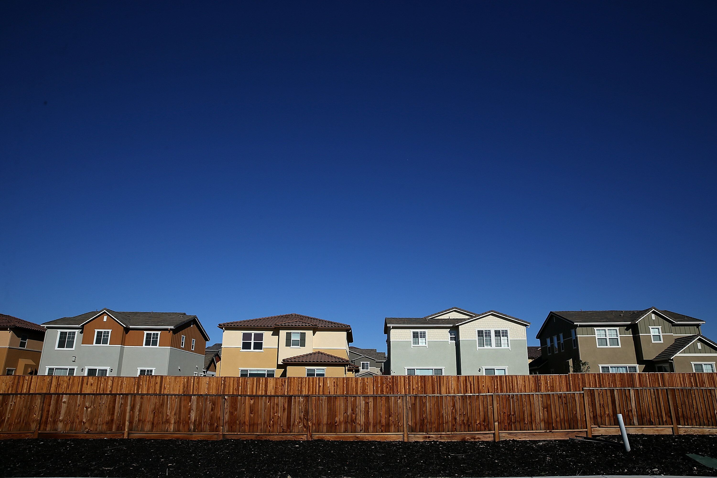 A row of new single-family homes at a housing development in Dublin, California. Encouraging all-electric homes would contrib