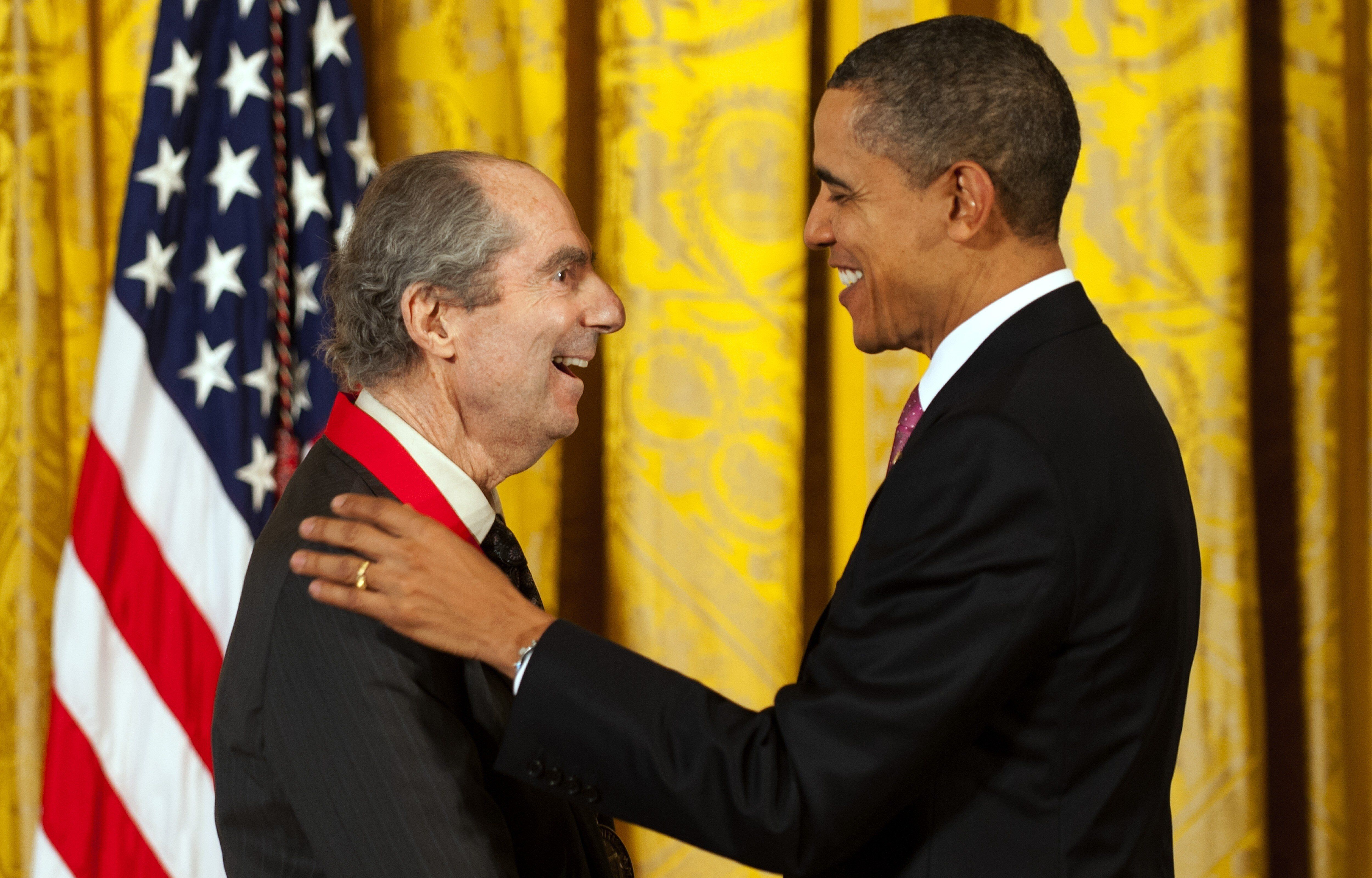 President Barack Obama presents the National Humanities Medal to novelist Philip Roth in 2011.