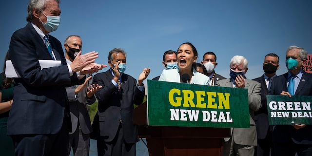 Rep. Alexandria Ocasio-Cortez, D-N.Y., speaks during a press conference to re-introduce the Green New Deal in front of the Capitol in Washington on Tuesday, April 20, 2021. (Photo by Caroline Brehman/CQ-Roll Call, Inc via Getty Images)