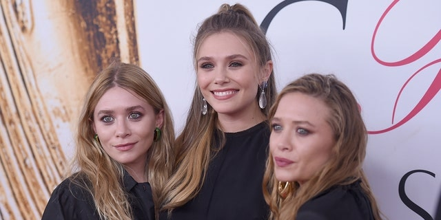 Elizabeth Olsen (center) said that she considered using a different last name to avoid 'nepotism' due to being related to Mary-Kate and Ashley Olsen. (Photo by Jamie McCarthy/Getty Images)