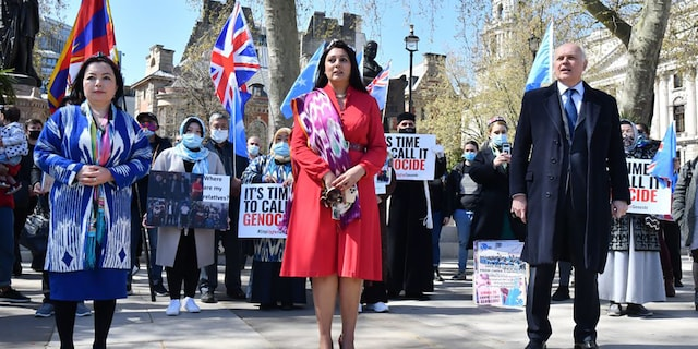 British Conservative Party MPs Nusrat Ghani (C) and Iain Duncan Smith (R) join members of the Uyghur community as they demonstrate to call on the British parliament to vote to recognize alleged persecution of China's Muslim minority Uyghur people as genocide and crimes against humanity in London on April 22, 2021. (Photo by JUSTIN TALLIS / AFP) (Photo by JUSTIN TALLIS/AFP via Getty Images)