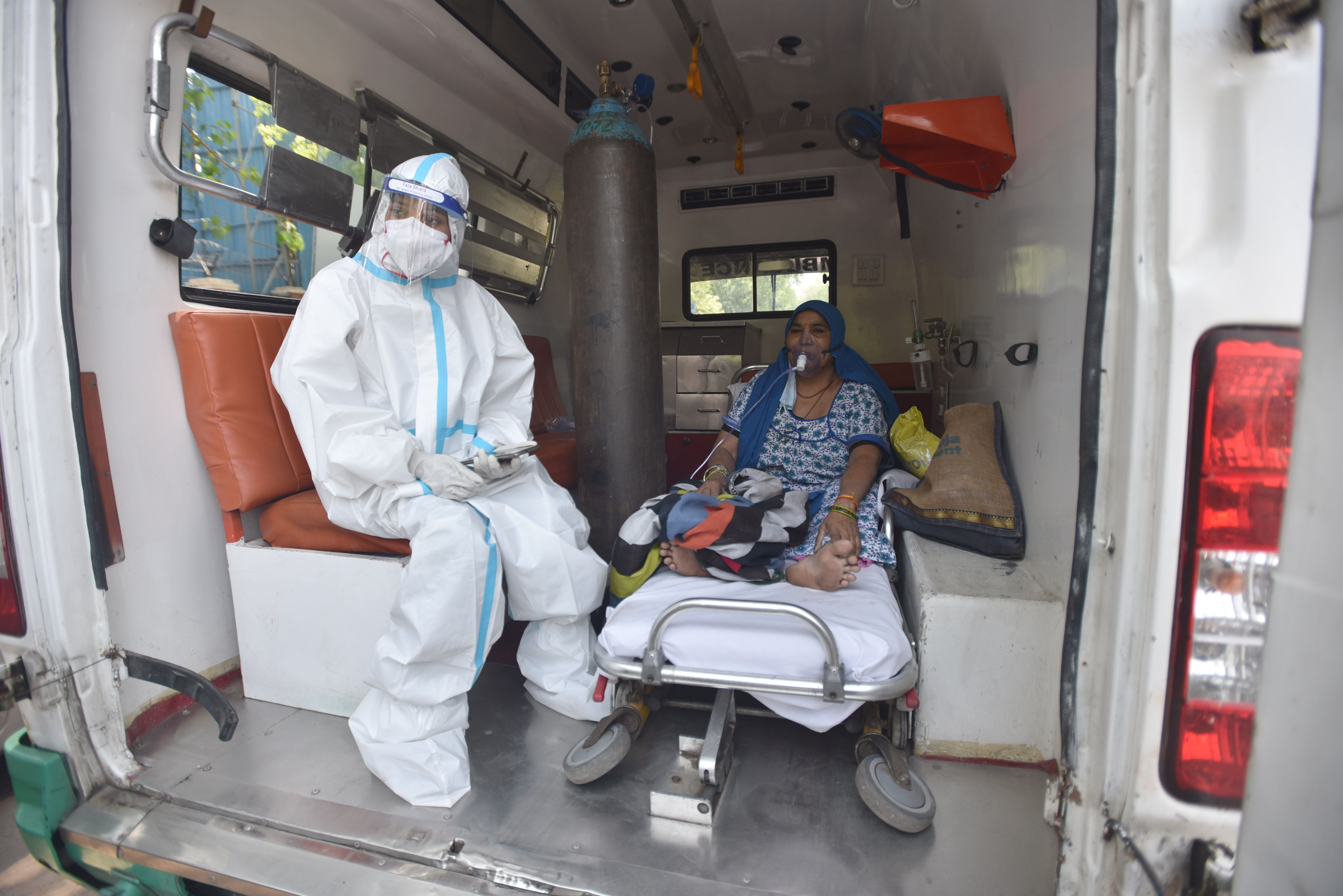 A COVID-19 patient seen inside an ambulance while waiting for admission amid shortage of beds, at LNJP Hospital on April 22,