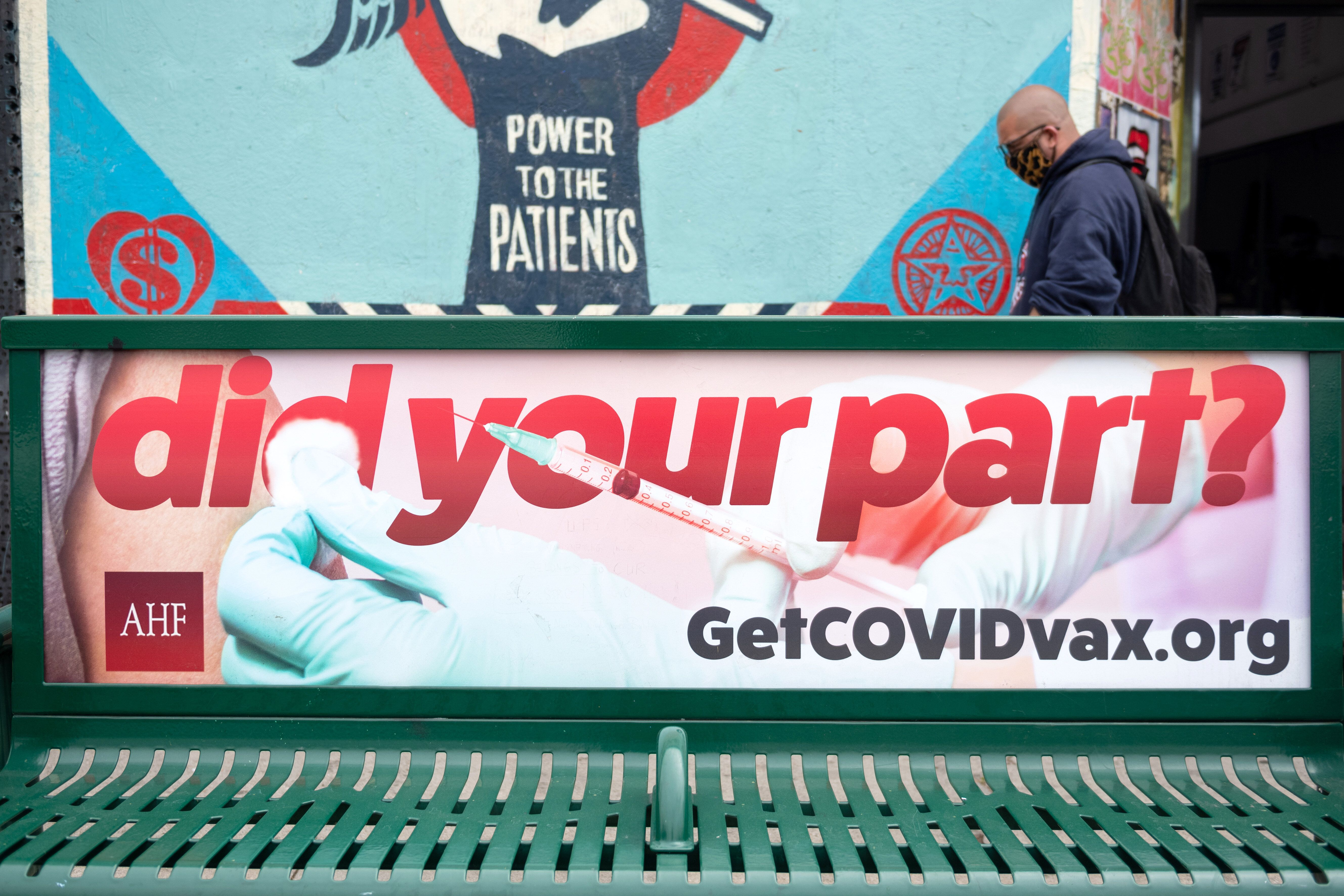 A bus bench ad encourages people to get the COVID-19 vaccine on Melrose Avenue amid the coronavirus pandemic on April 22, 202