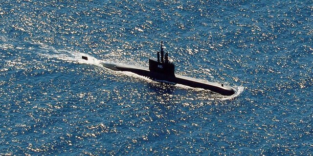 The Indonesian Navy submarine KRI Alugoro sails during a search for KRI Nanggala, another submarine that went missing while participating in a training exercise on Wednesday, in the waters off Bali Island, Indonesia, Thursday, April 22, 2021. (AP Photo/Eric Ireng)