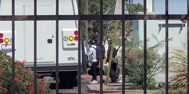 Migrants at hotels in Arizona are seen being transported.