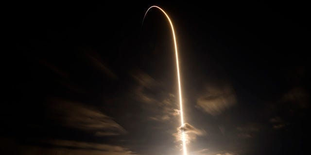 A SpaceX Falcon 9 lifts off in this time exposure from Launch Complex 39A Friday, April 23, 2021, at the Kennedy Space Center in Cape Canaveral, Fla. Four astronauts will fly on the SpaceX Crew-2 mission to the International Space Station. (AP Photo/Chris O'Meara)
