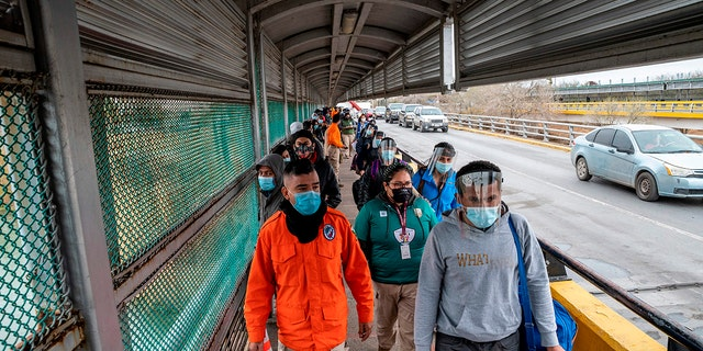 Migrants approach the U.S. border on Gateway International Bridge in Brownsville, Texas on March 2, 2021. (Getty Images)
