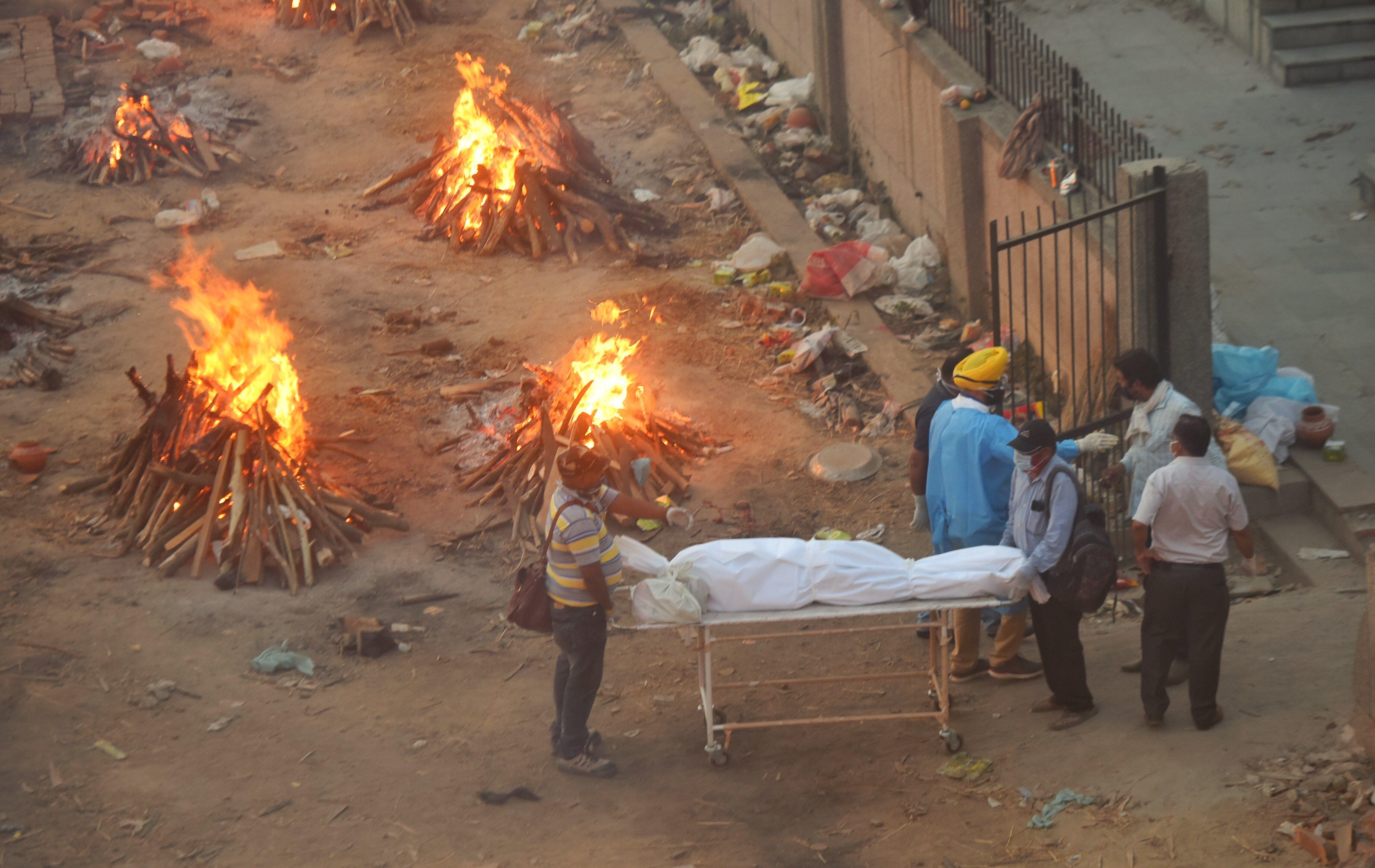 NEW DELHI, INDIA - APRIl 23: COVID-19 victims being cremated at Seemapuri crematorium, on April 23, 2021 in New Delhi, India.