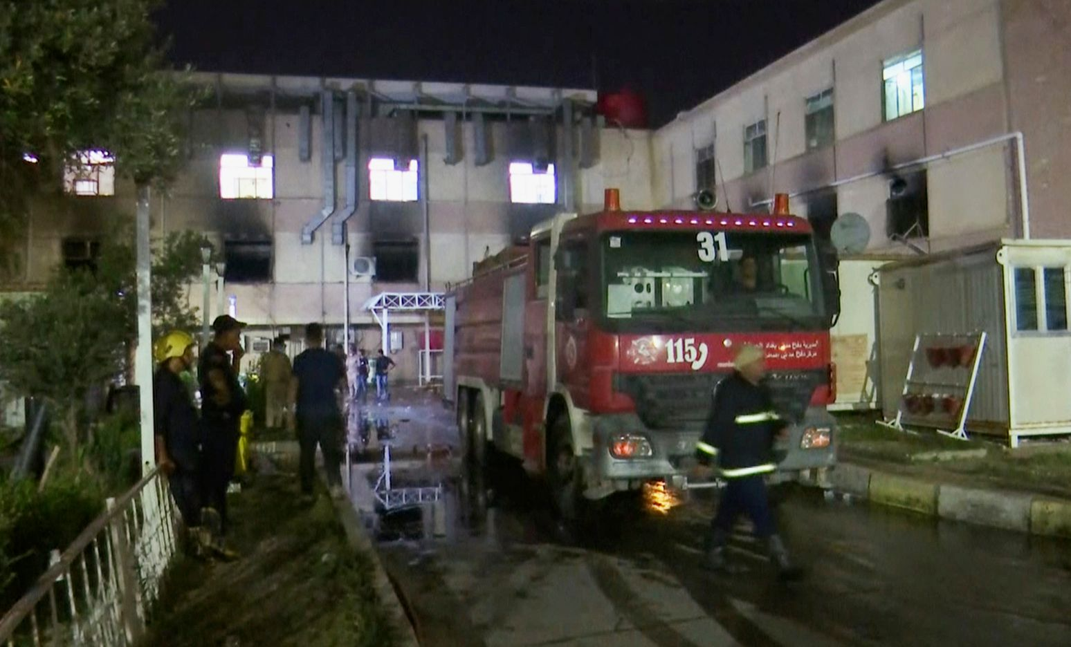 In this image made from video, first responders work the scene of a hospital fire in Baghdad on Saturday, April 24, 2021. The