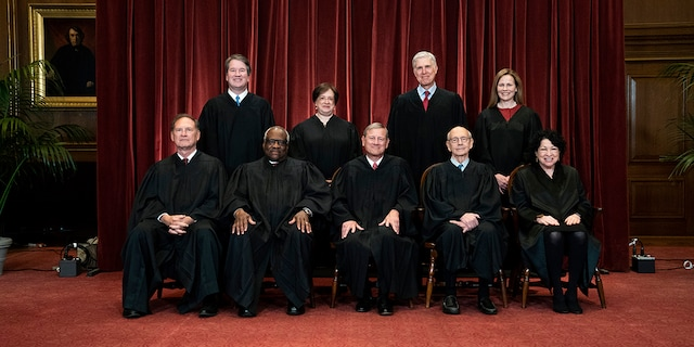 Members of the Supreme Court pose for a group photo at the Supreme Court in Washington on April 23, 2021. (Erin Schaff/The New York Times via AP, Pool, File)