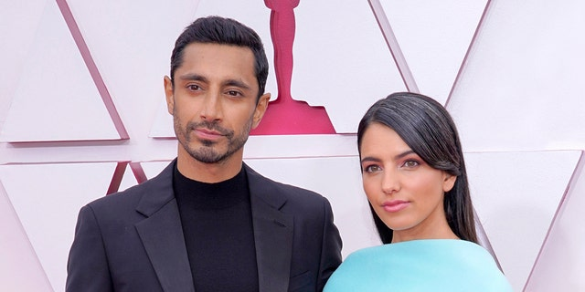 Actor Riz Ahmed and author Fatima Farheen Mirza married at some point over the last year and made their red carpet debut at the Academy Awards. (Photo by Chris Pizzello-Pool/Getty Images)