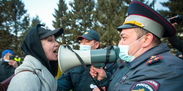 FILE - A woman argues with police officer during a protest in support of jailed opposition leader Alexei Navalny in Ulan-Ude, the regional capital of Buryatia, a region near the Russia-Mongolia border, Russia, in this Wednesday, April 21, 2021, file photo. (AP Photo/Anna Ogorodnik, File)
