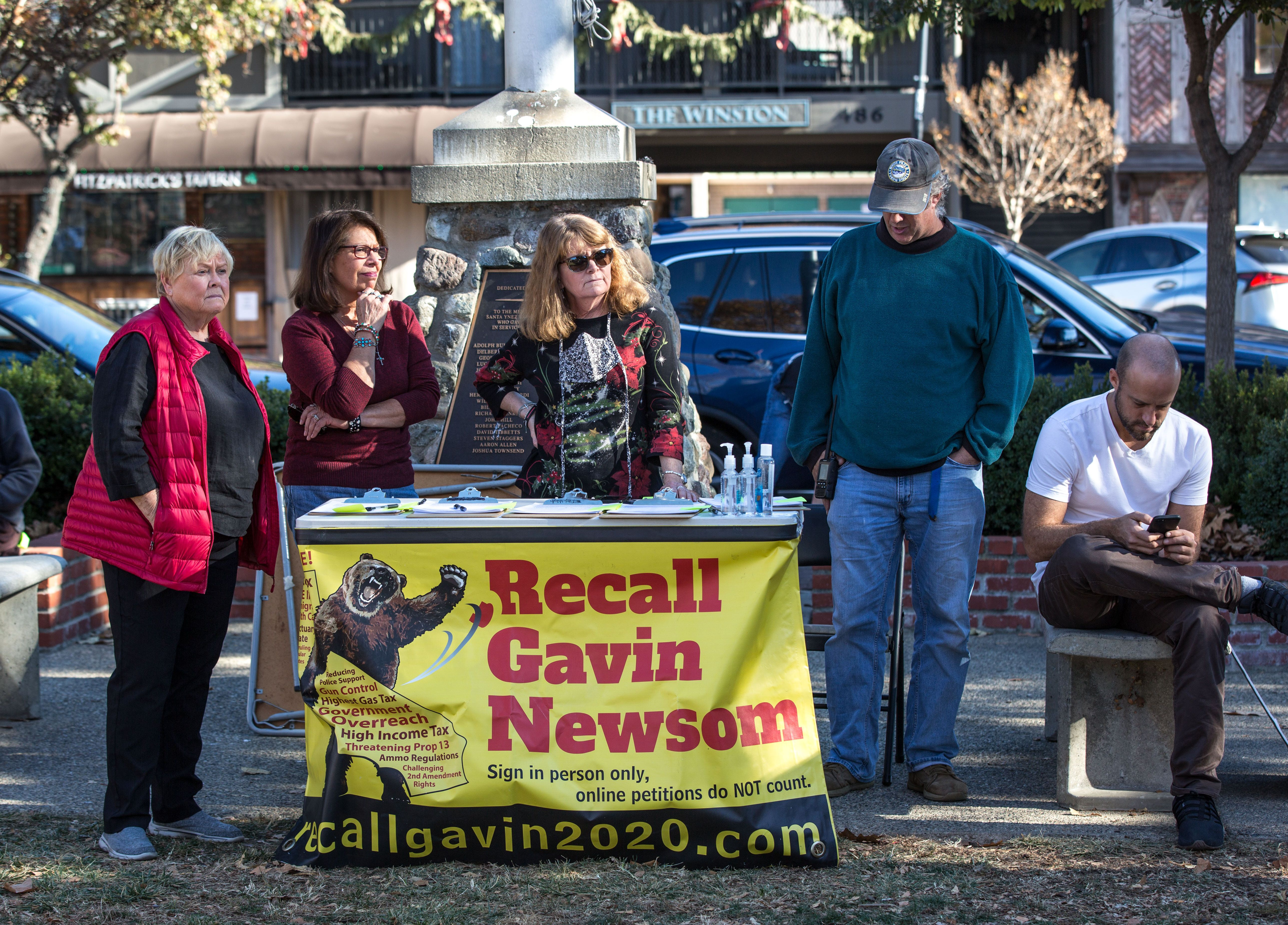 """People circulate a """"Recall Gavin Newsom"""" petition in Solvang, California, during a pro-Donald Trump rally."""
