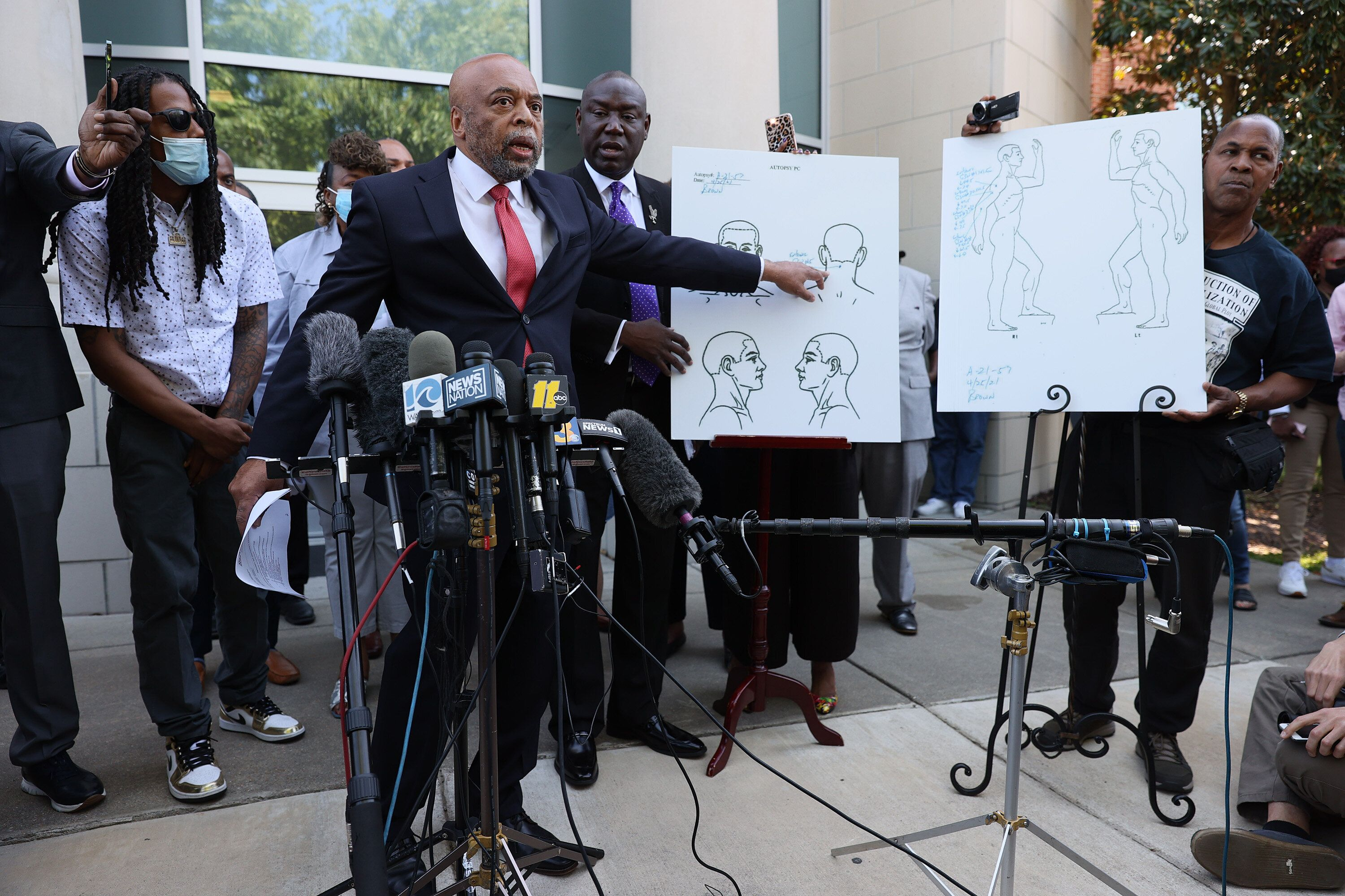 Wayne Kendall, one of the lawyers representing the family of Andrew Brown Jr., points to an autopsy chart that his team condu