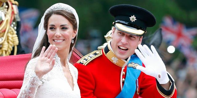 Catherine, Duchess of Cambridge and Prince William, Duke of Cambridge (wearing his red tunic uniform of the Irish Guards, of which he is Colonel) travel down The Mall, on route to Buckingham Palace, in the 1902 State Landau horse-drawn carriage following their wedding ceremony at Westminster Abbey on April 29, 2011, in London, England. The marriage of Prince William, the second in line to the British throne to Catherine Middleton was led by the Archbishop of Canterbury and was attended by 1900 guests, including foreign Royal family members and heads of state. Thousands of well-wishers from around the world have also flocked to London to witness the spectacle and pageantry of the royal wedding.
