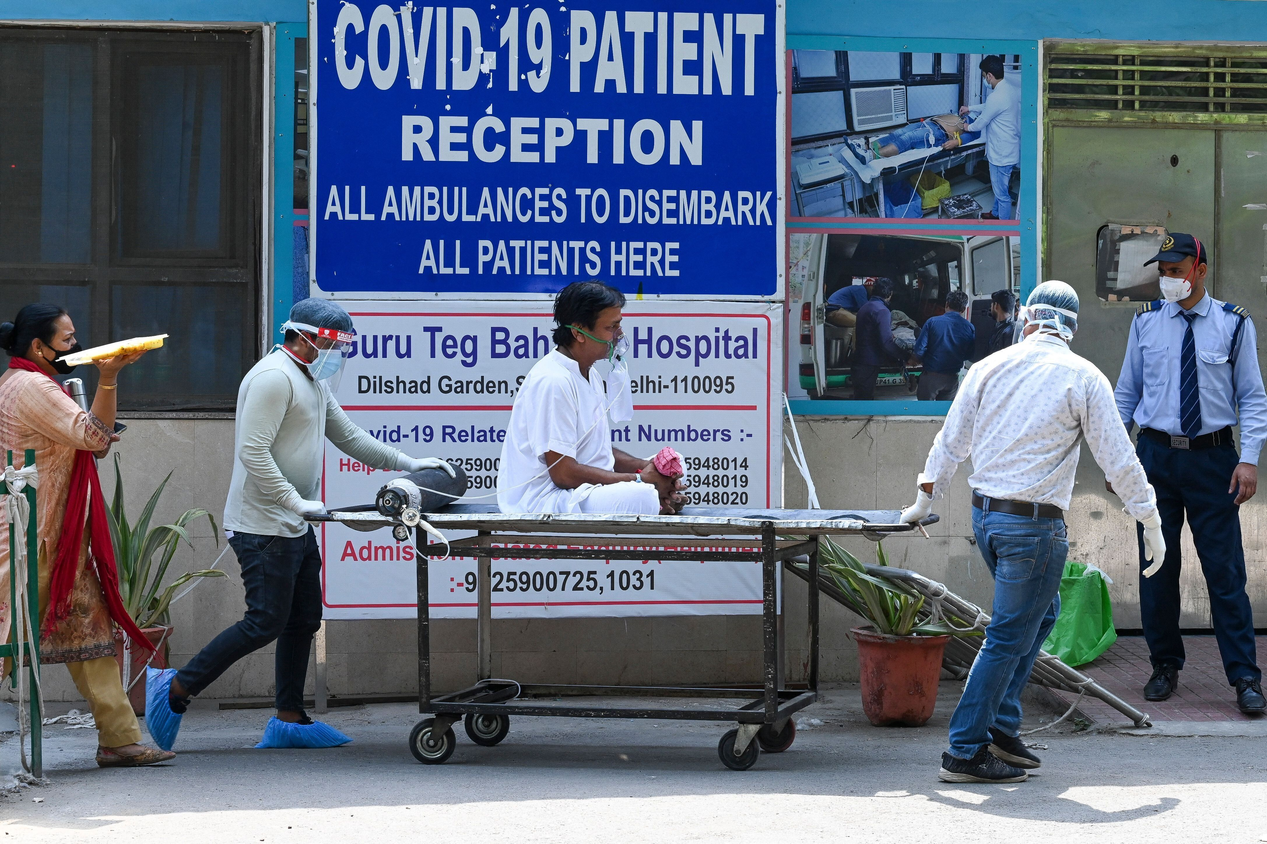 A coronavirus patient is shifted to a ward after admission at GTB hospital in New Delhi on April 29, 2021.