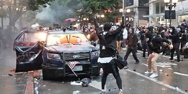 Kelly Thomas Jackson, 20, allegedly threw Molotov cocktails at two Seattle police vehicles during a May 30 protests that devolved into a riot.