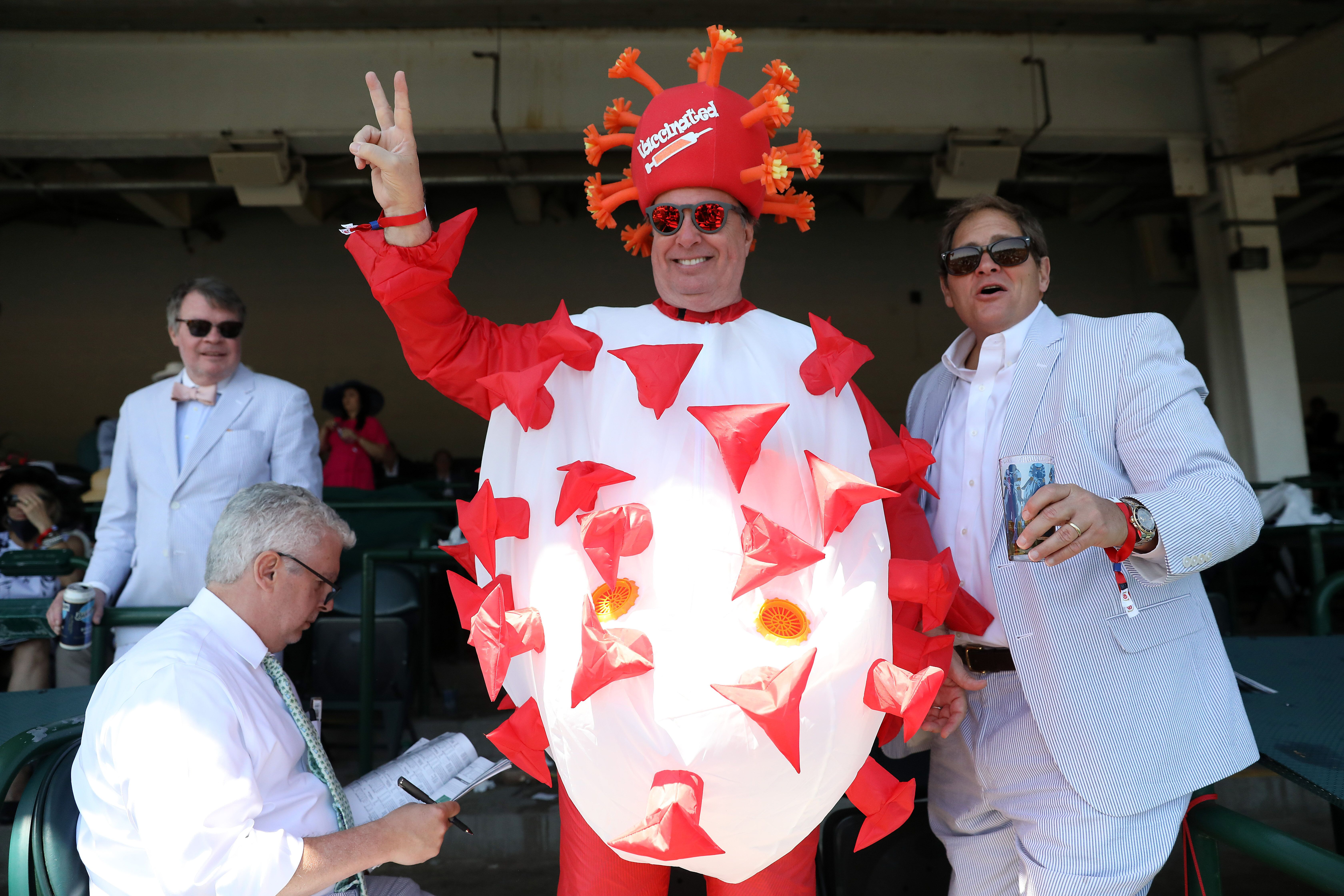 Kentucky Derby spectator Mark Ferguson of Dallas, Texas, wearing a COVID-19 costume at Saturday's event.