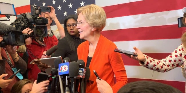 "Democratic presidential candidate Sen. Elizabeth Warren speaks with reporters while campaigning in Marshalltown, Iowa on Jan. 12, 2019. Warren comes out with a new book, ""Persist"" on May 4, 2021."