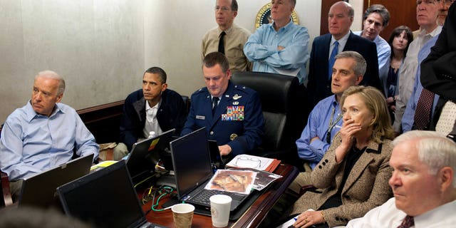 May 1, 2011: Secretary of State Hillary Rodham Clinton, President Barack Obama and Vice President Joe Biden, along with with members of the national security team, receive an update on the mission against Usama bin Laden in the Situation Room of the White House.