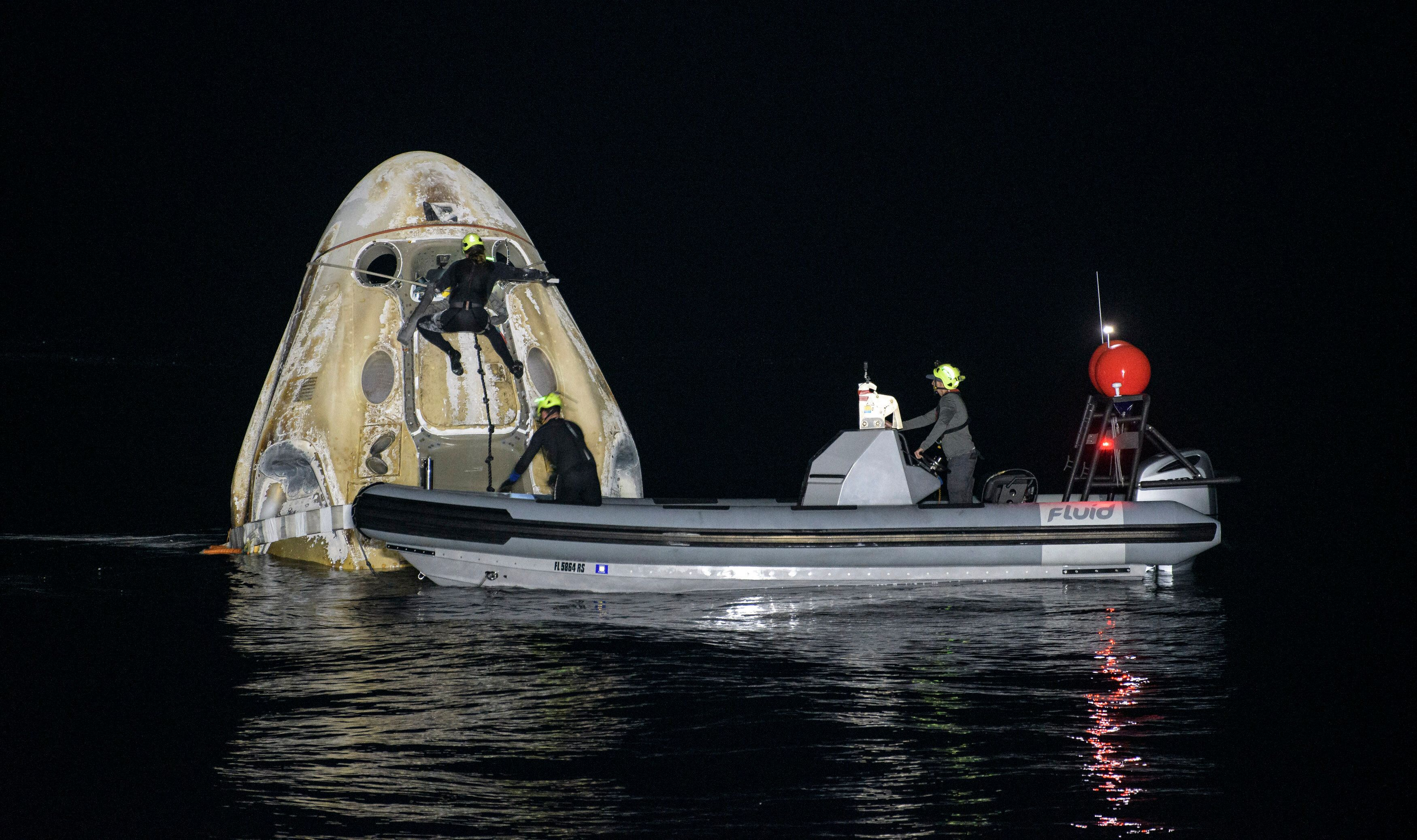 PANAMA CITY, FL. - MAY 02: In this NASA handout, Support teams work around the SpaceX Crew Dragon Resilience spacecraft short