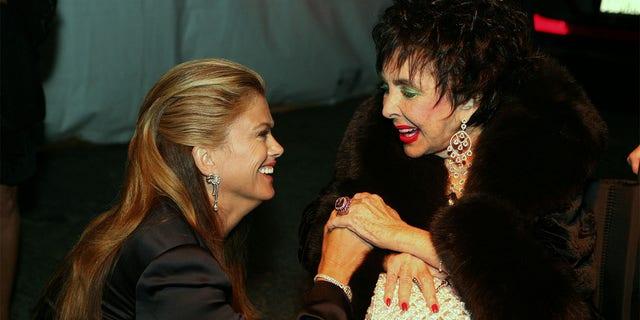 Kathy Ireland and actress Elizabeth Taylor at Macy's Passport Gala 2008 at Barker Hangar on September 25, 2008, in Santa Monica, California.
