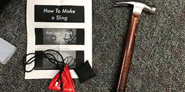 Objects seized from demonstrators included a hammer and instructions on how to make a sling shot. (Portland Police Bureau)