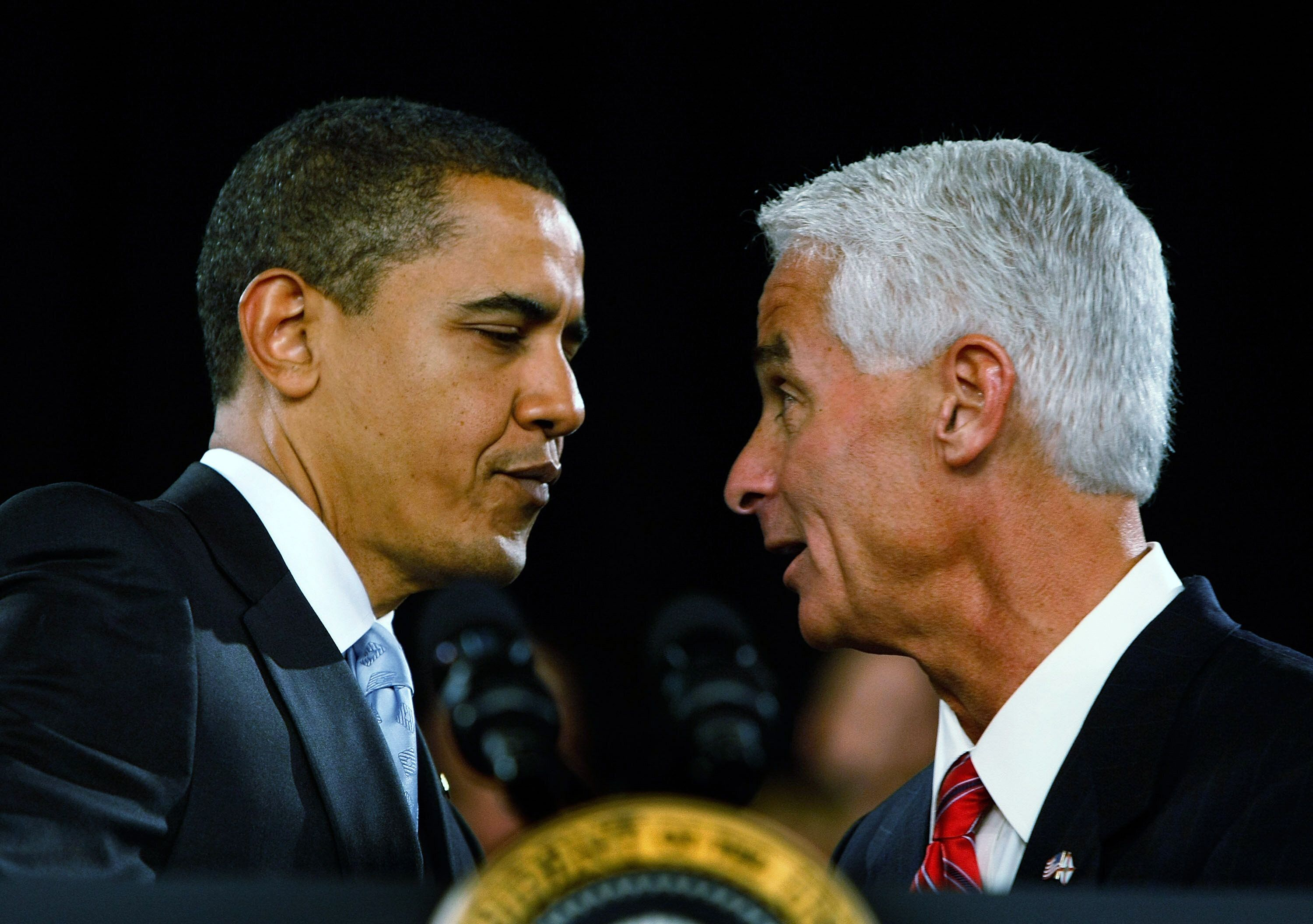 Then-Republican Gov. Charlie Crist introduces then-President Barack Obama during a town hall meeting on Feb. 10, 2009, in For