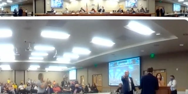 Protesters are seen disrupting a Granite School District Board of Education meeting on Tuesday. (Granite School District)