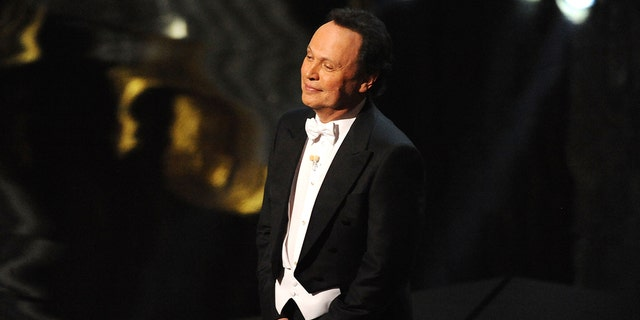 Host Billy Crystal speaks onstage during the 84th Annual Academy Awards held at the Hollywood & Highland Center on February 26, 2012 in Hollywood, California.
