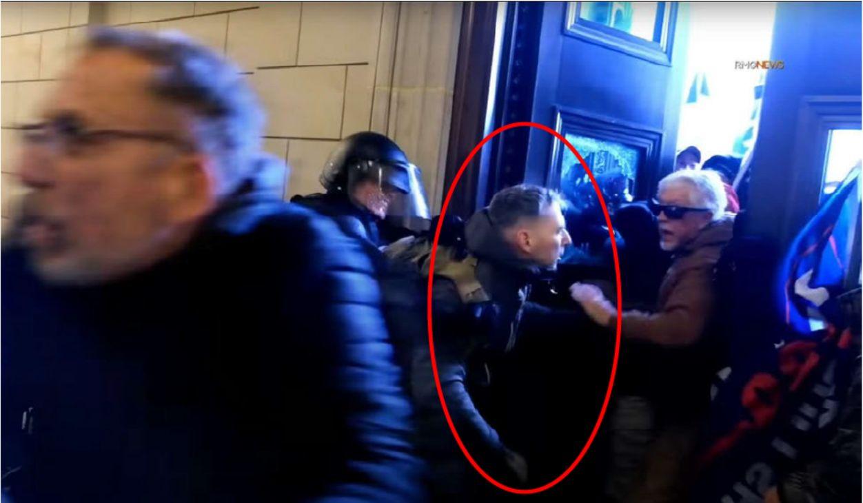 Marine Corps Major Christopher Warnagiris, seen here allegedly helping rioters breach the Capitol building on Jan. 6, 2021, n