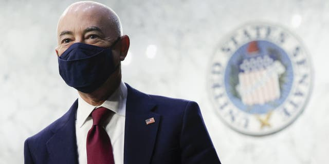 Homeland Security Secretary Alejandro Mayorkas looks on during a break in a Senate Appropriations committee hearing to examine domestic extremism, Wednesday, May 12, 2021 on Capitol Hill in Washington. (Alex Wong/Pool via AP)