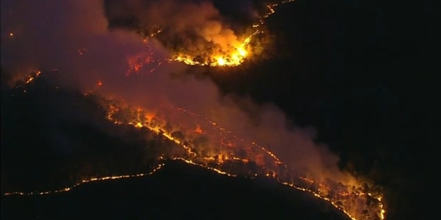 Crews continue battling 1,000 acre forest fire in Little Egg Harbor Township on Sunday.