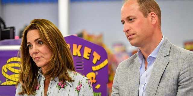 Prince William, Duke of Cambridge and Catherine, Duchess of Cambridge at Island Leisure Amusement Arcade to speak to local business owners about the impact of COVID-19 on the tourism sector on August 5, 2020 in Barry, Wales.