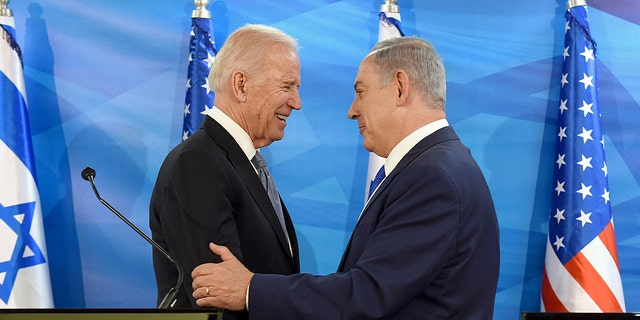 Former U.S. Vice President and current President Joe Biden (left) shakes hands with Israeli Prime Minister Benjamin Netanyahu as they deliver joint statements during their meeting in Jerusalem March 9, 2016. (REUTERS/Debbie Hill/Pool/File Photo)