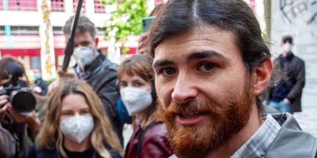 The defendant identified only as 1st Lt. Franco A. due to German privacy rules, walks to a court for the start of a trial on charges of preparing a serious act of violence endangering the state in Frankfurt, Germany, Thursday, May 20, 2021.