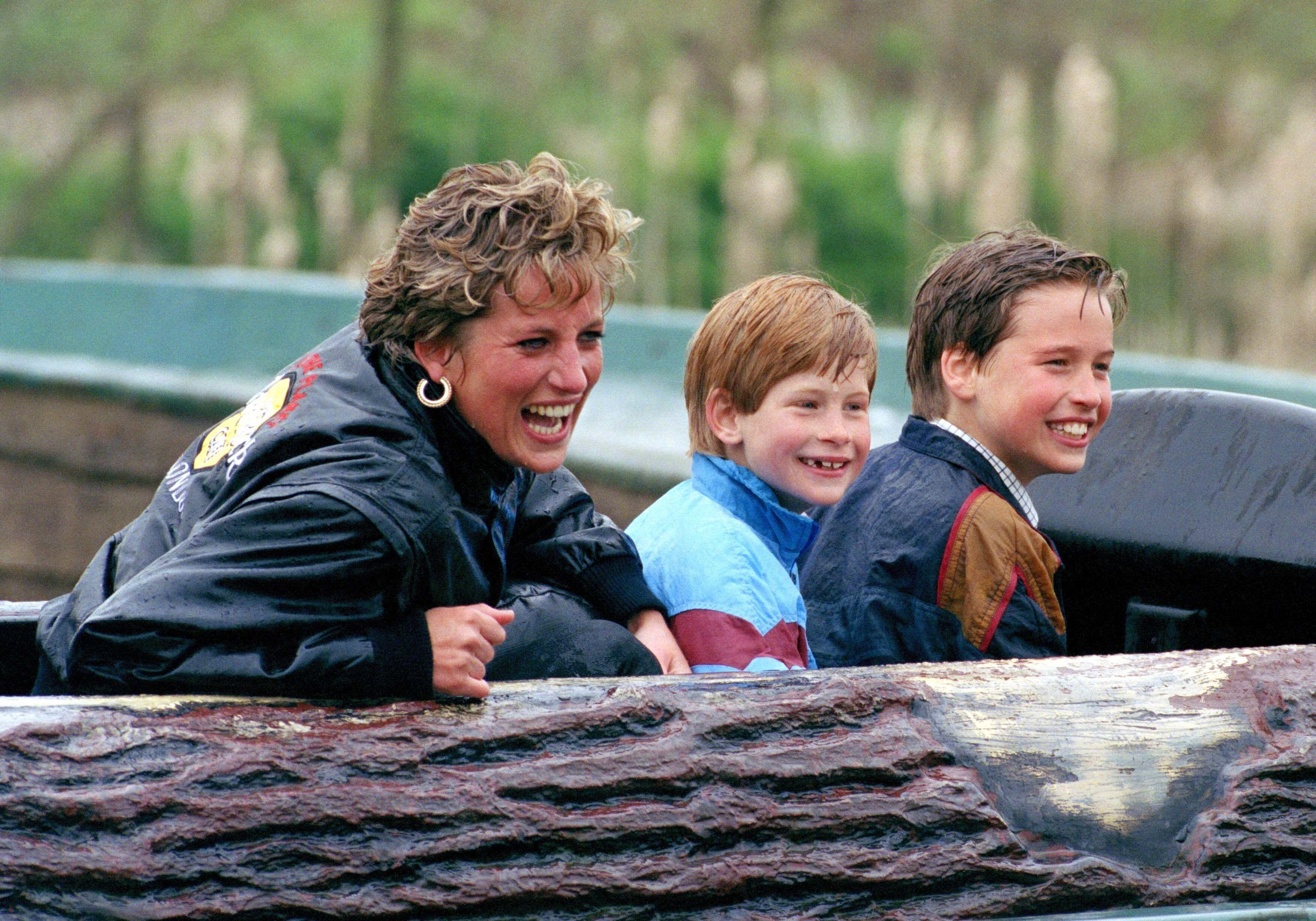 Princess Diana, Prince Harry (center) and Prince William (right) at Thorpe Park.