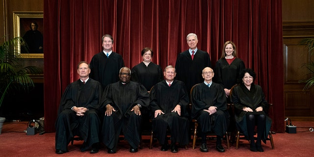 In this April 23, 2021, file photo members of the Supreme Court pose for a group photo at the Supreme Court in Washington. Seated from left are Associate Justice Samuel Alito, Associate Justice Clarence Thomas, Chief Justice John Roberts, Associate Justice Stephen Breyer and Associate Justice Sonia Sotomayor, Standing from left are Associate Justice Brett Kavanaugh, Associate Justice Elena Kagan, Associate Justice Neil Gorsuch and Associate Justice Amy Coney Barrett. This is the first photo of all the justices together after the death of late Justice Ruth Bader Ginsburg and Barrett's confirmation. (Erin Schaff/The New York Times via AP, Pool, File)