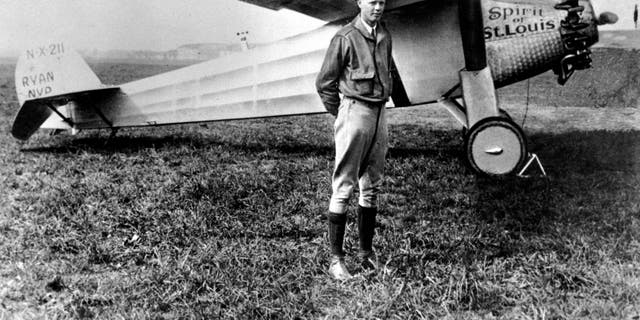 Charles A. Lindbergh posing with his plane in 1927. (AP Photo, File)