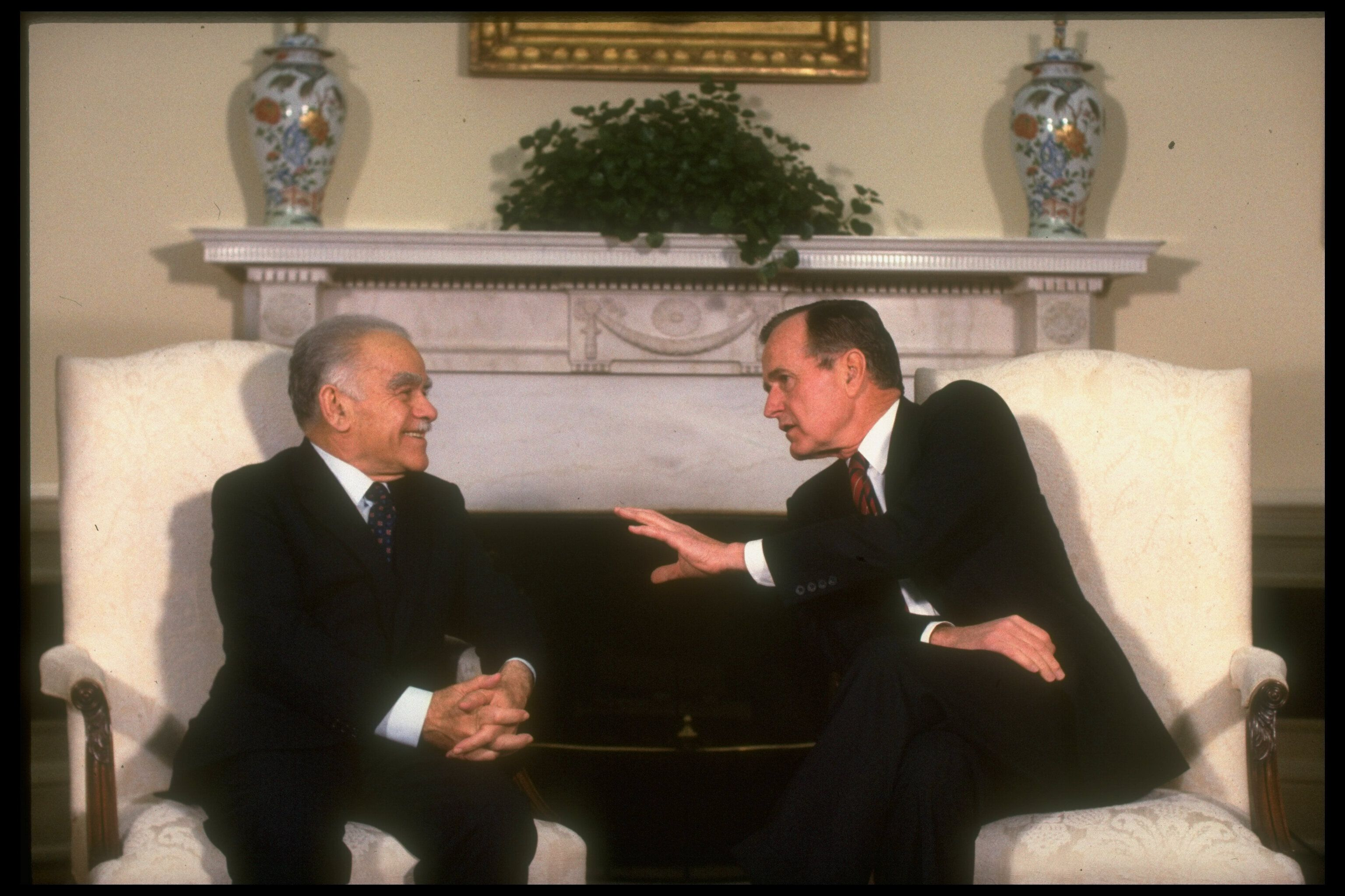 President George H.W. Bush, right, meets with Israeli Prime Minister Yitzhak Shamir in an undated photo. Bush's pressure cont