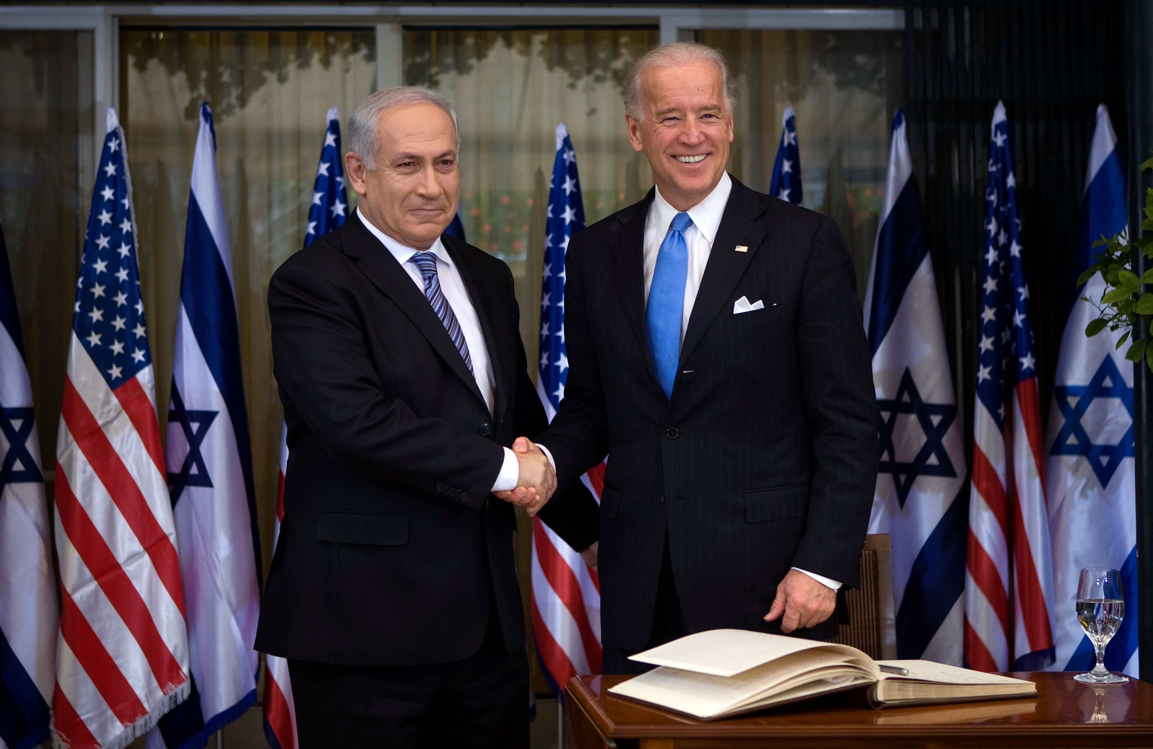 President Joe Biden, right, greets Israeli Prime Minister Benjamin Netanyahu in March 2010. Some U.S. foreign policy hands ar