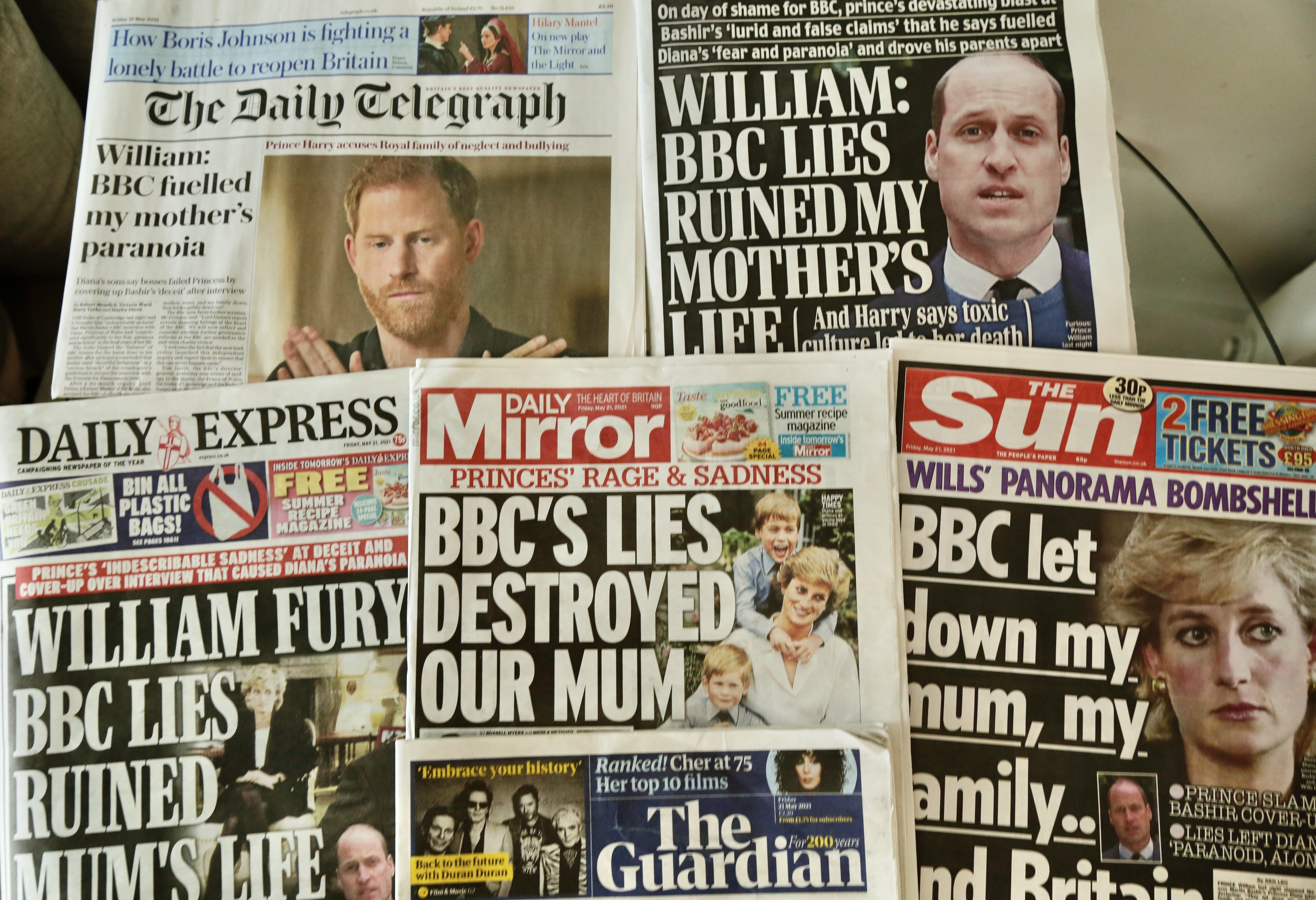 An arrangement of UK daily newspapers from May 21 shows front page headlines reporting Prince William and his brother Prince