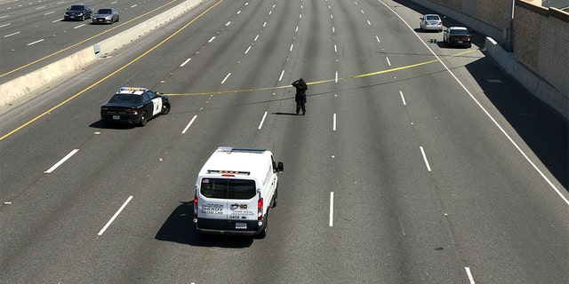 Orange, CA - May 21: A crime scene investigator photographs the scene while the California Highway Patrol secures the northbound lanes of the 55 Freeway near Chapman Avenue were a 6-year-old boy was fatally shot during apparent road rage incident Friday, May 21, 2021 in Orange, CA. The suspect fled immediately after the shooting near West Chapman Avenue as police officers and paramedics responded to the gunfire shortly after 8 a.m., authorities said. The boys mother was traveling on the northbound freeway with her child in the booster seat when the shooting occurred, CHP officials said. Witnesses reported hearing a gun shot from a white sedan right before the childs mother pulled her vehicle over to the shoulder. This was an isolated road rage incident, said CHP Officer Florentino Olivera. He said the driver of the white sedan shot into the back of the mothers Chevy Cruze sedan (shown at upper right) and then fled. (Allen J. Schaben / Los Angeles Times via Getty Images)