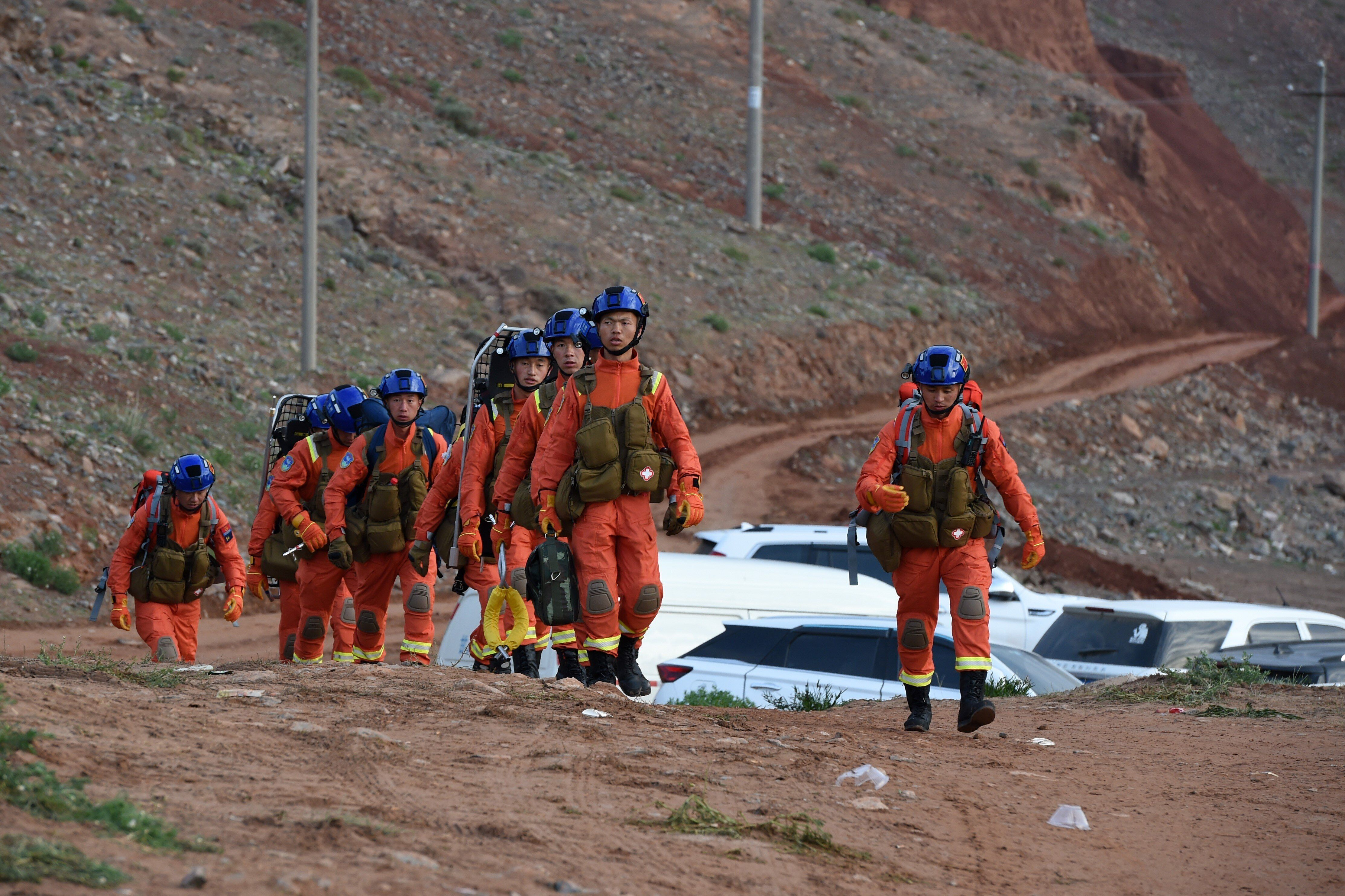 Rescuers walk into the accident site to search for survivors in Jingtai County of Baiyin City, northwest China's Gansu Provin